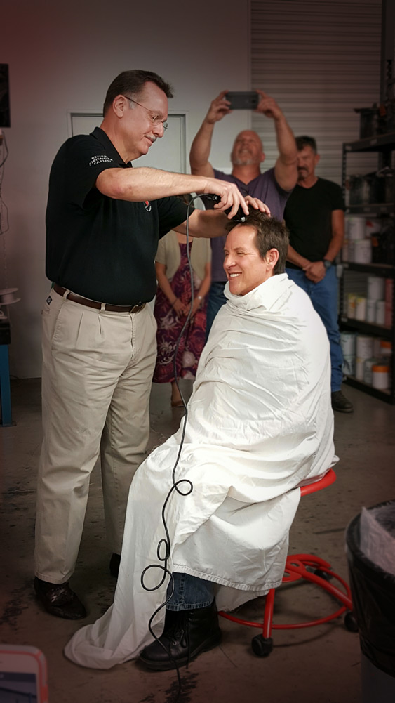 Scott Saxman, New Business Development Director gets first cut at CEO Marty Mares.